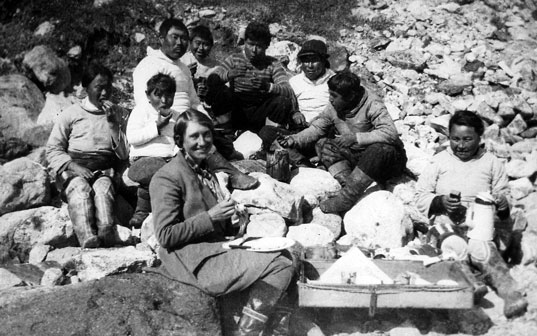 Isobel Wylie Hutchison and the crew of her umiak at lunch, Tasermiut Fjord, Greenland, 1927. Image courtesy of RSGS.