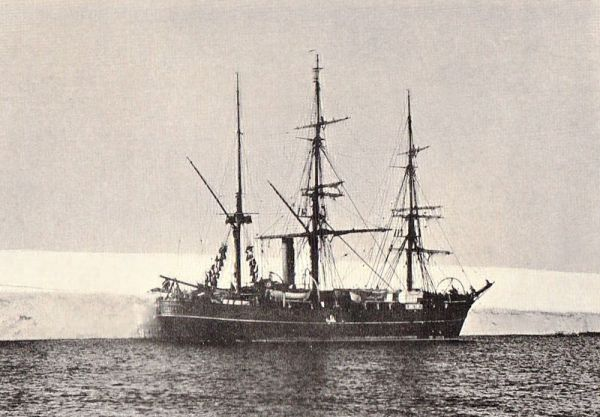 The 'Discovery' in 1902, alongside the Antarctic ice barrier